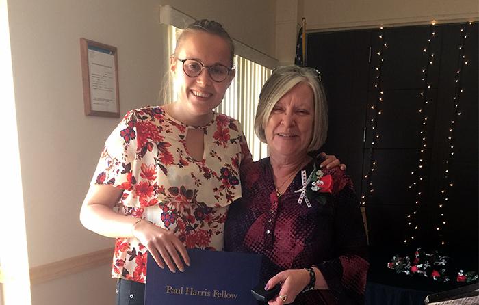 Rotarian Deborah Corbin presenting Zoe Kleijnen with a Paul Harris Award